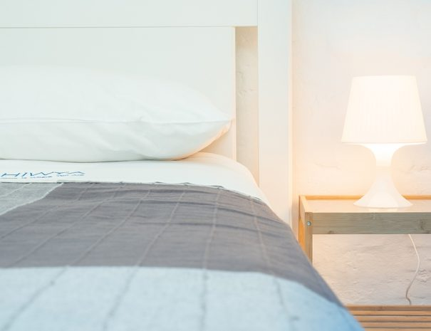 Detail of single bed with lamp