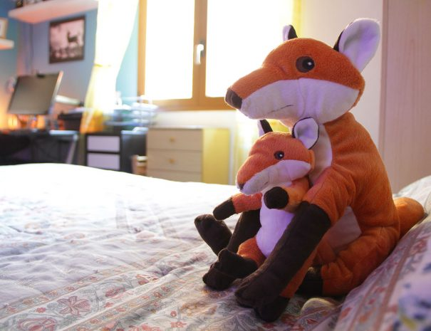 Foxes peluche on the bed