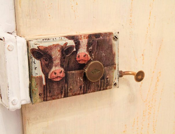 A door lock with cows printed on it